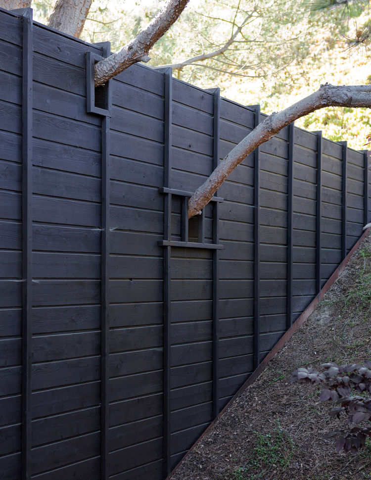 Outdoor charred cedar fence