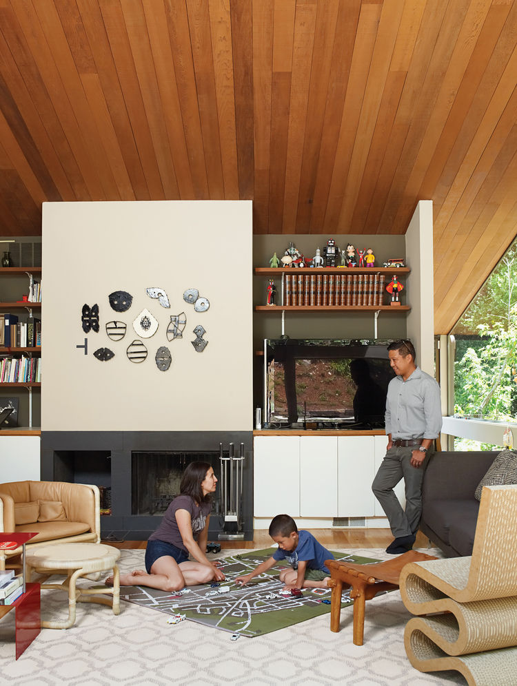 Modern living room with Wiggle chair by Frank Gehry and local artwork