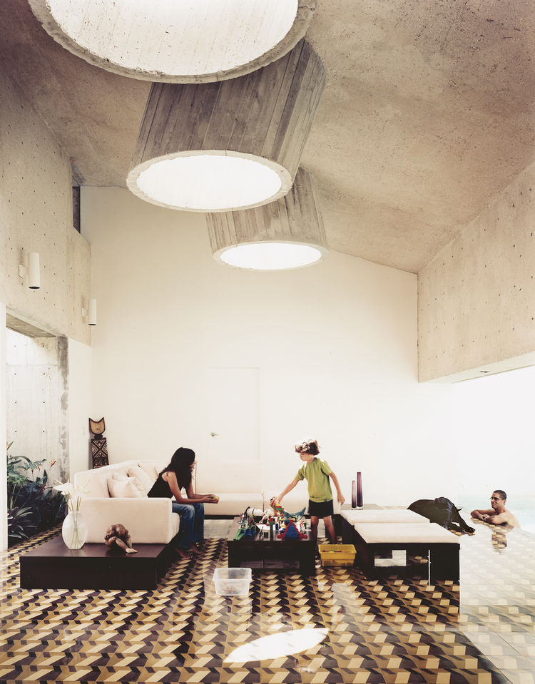 Modern concrete living room with skylights