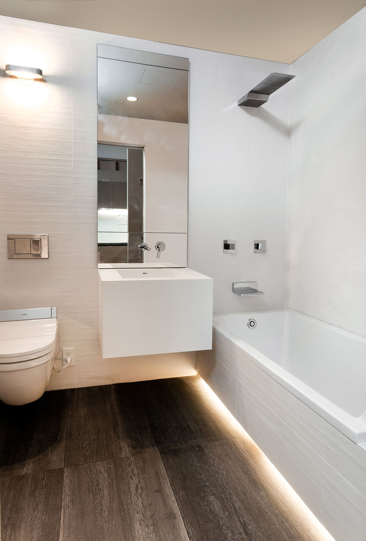 Modern small space bathroom with full length tub
