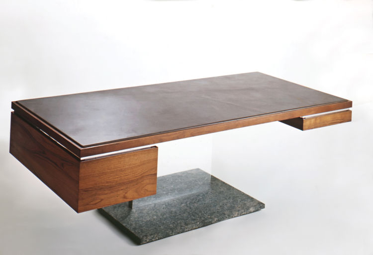 Leather, wood, and bronze table designed by Warren Platner
