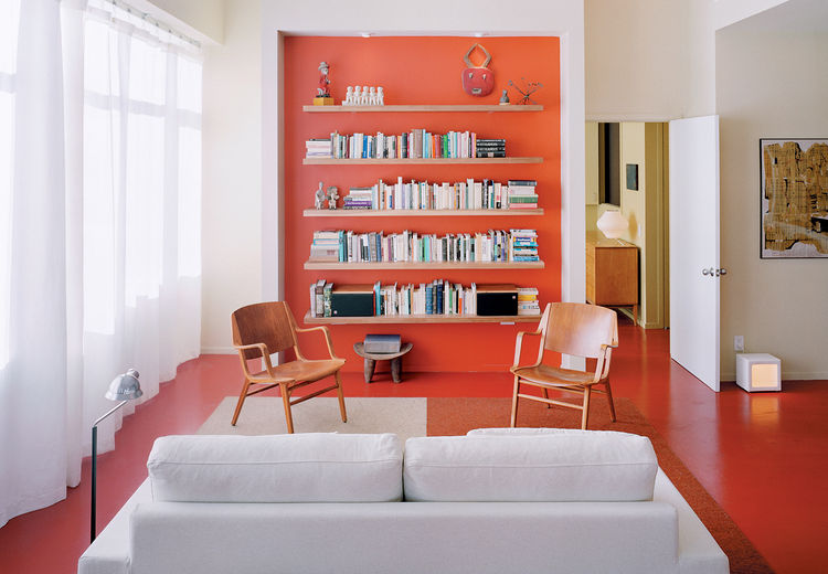 Clean white is supercharged with a background-to-floor-to-fore dose of coral. The adventurous decision to paint the floors makes the room. The background to the home's story is even more beguiling, as one urban resident brings Usonian design to a small ci