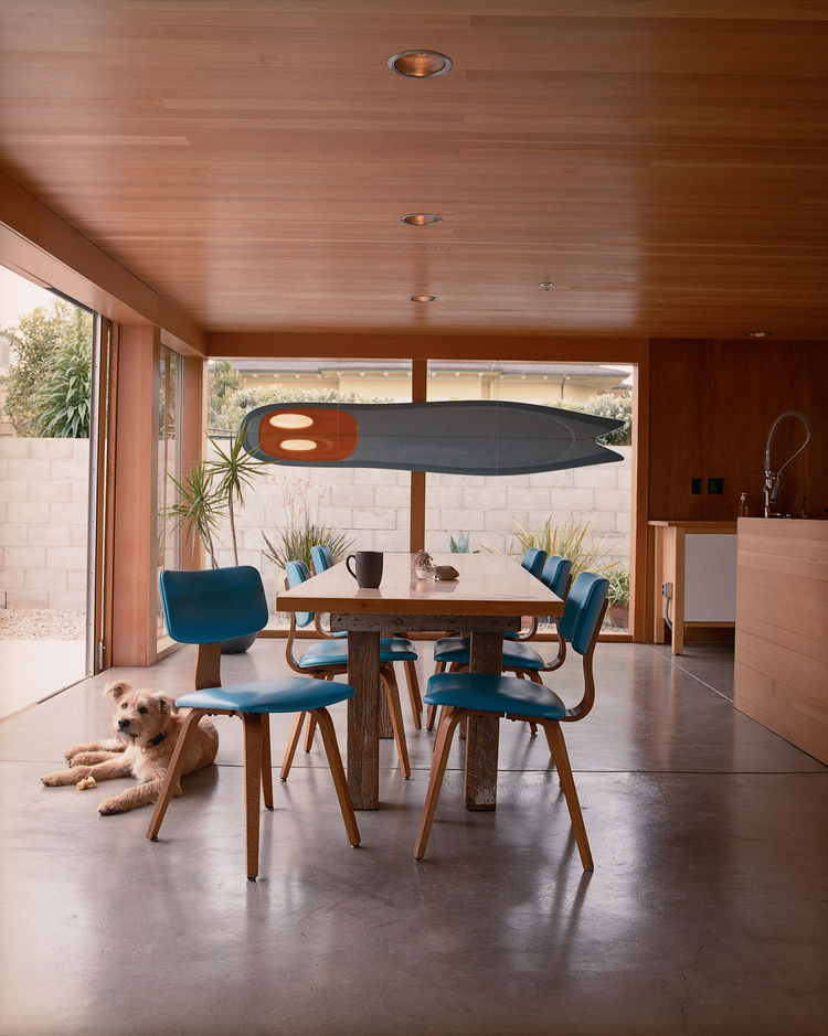 "To inexpensively re-create a classic modern look for a wood-paneled ceiling in a Montara, California, dining room, architect Michael Maltzan used Douglas fir tongue-and-groove flooring. <a href=""http://www.dwell.com/articles/the-full-montara.html"">Read th"