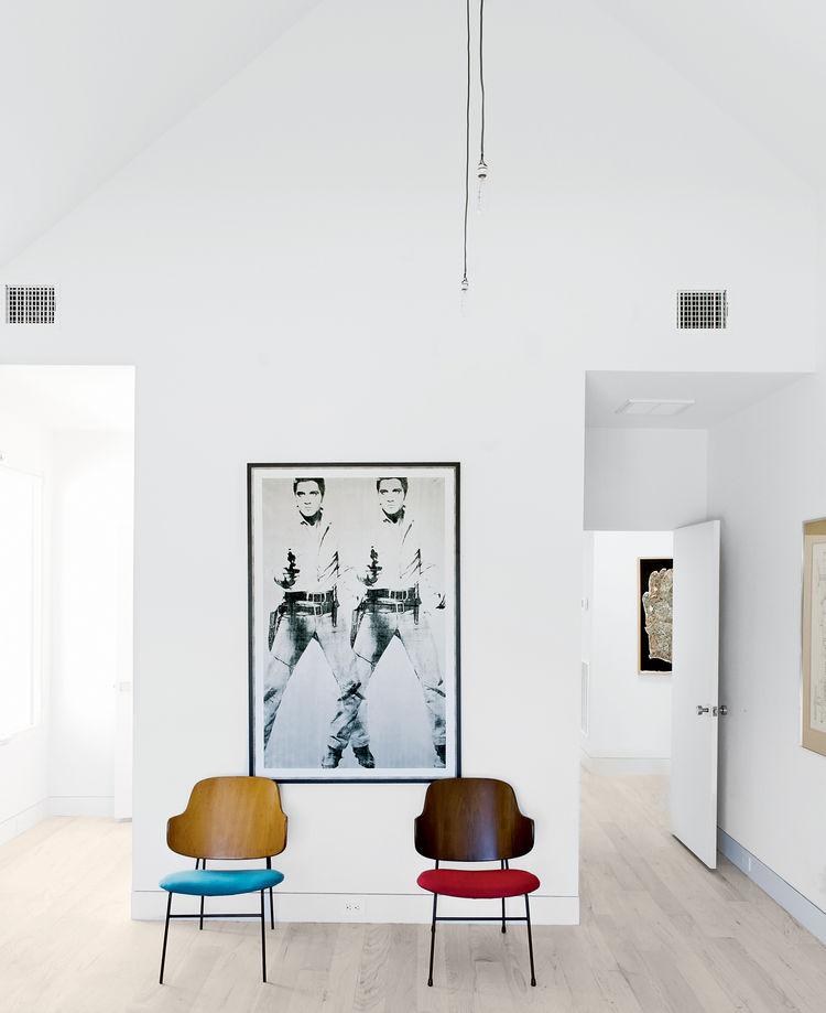 Modern upstairs bedroom with Kofod-Larsen chairs and Warhol print