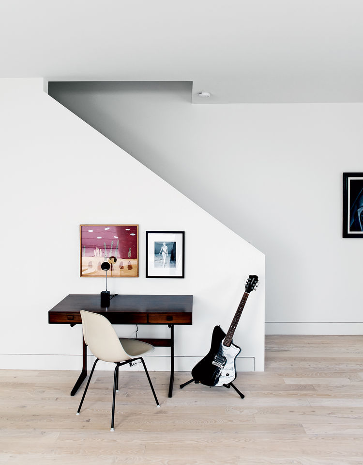 Staircase desk area with Eames side chair and vintage desk