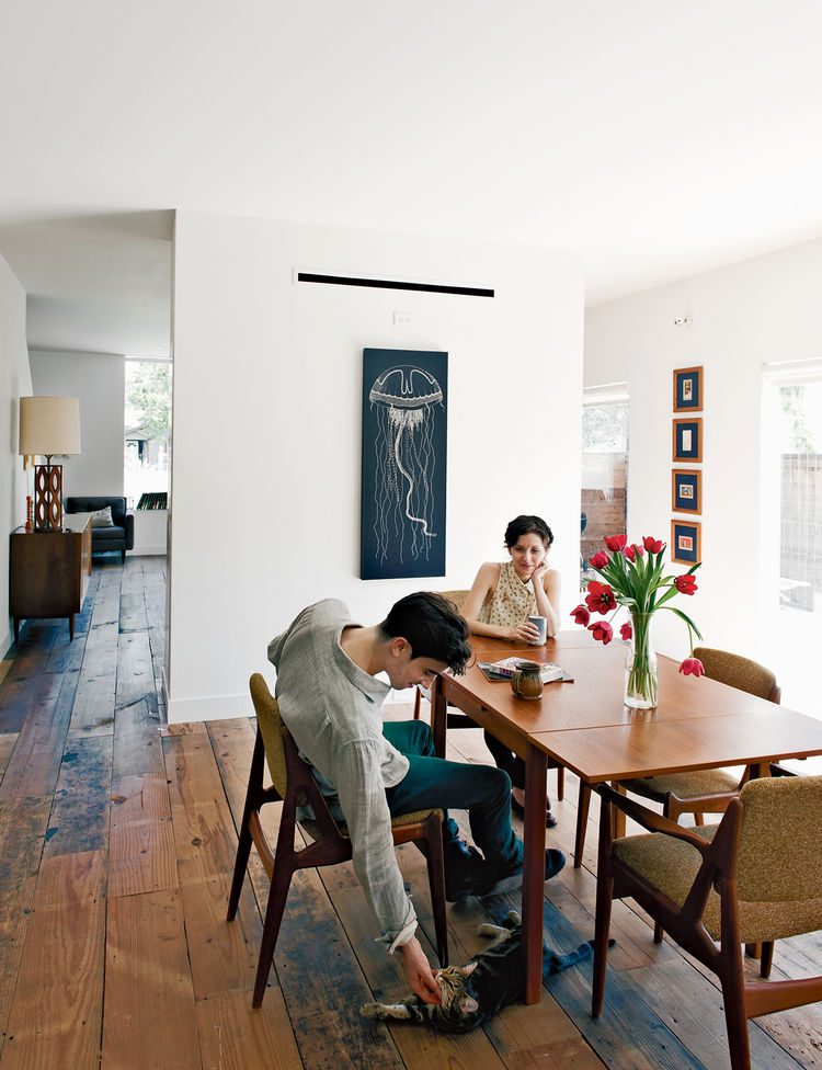 Dining room with wooden flooring and vintage furniture