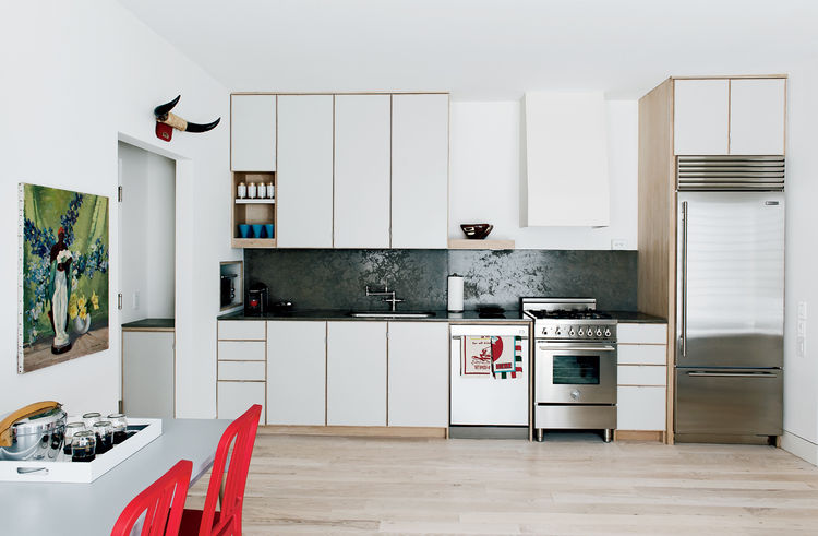 Modern kitchen with custom cabinetry and Sub-Zero fridge