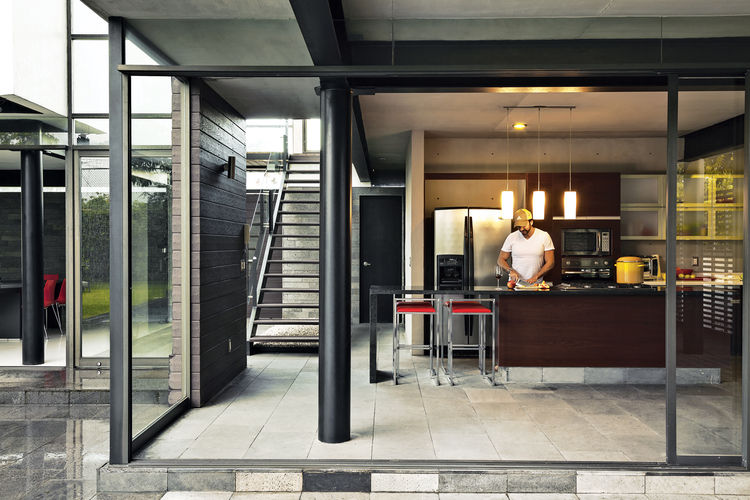 Modern kitchen with granite island and Porcelanosa cabinets