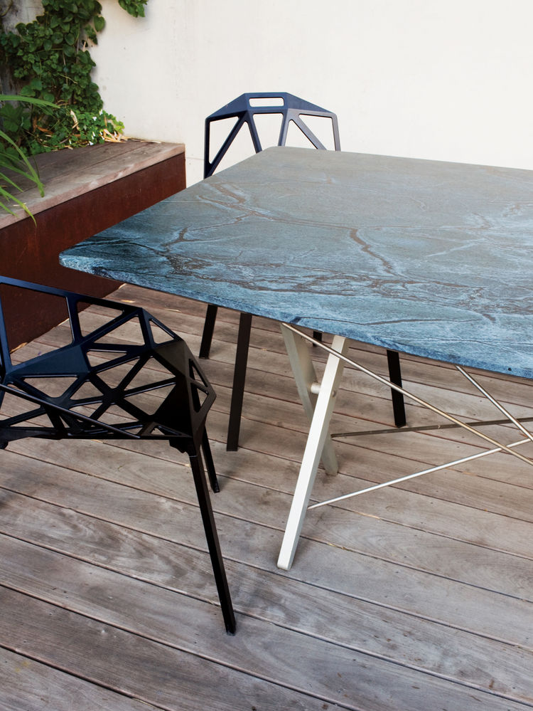 Outdoor dining table with custom top cut for a recycled base