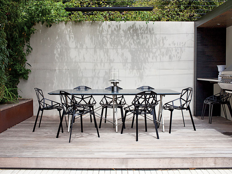 Outdoor raised dining nook with Konstantin Grcic Ones for Magis table and chairs
