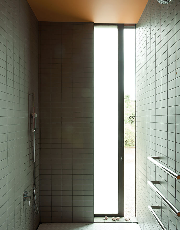 Tiled shower room with outdoor view