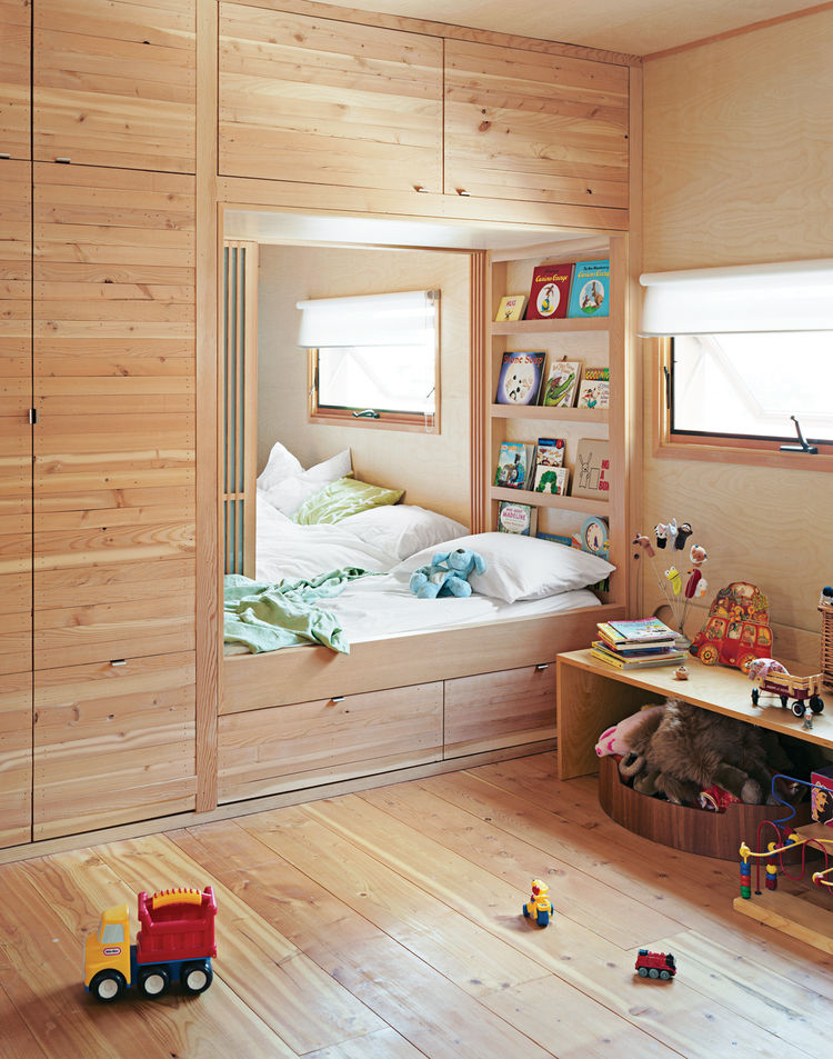 Only a set of sliding doors separates the kids' room from the master bedroom in a Toronto, Ontario, home. When the time is right, there's a track inlaid in the ceiling for a four-panel bifold wall to divide the space into two private rooms for the childre