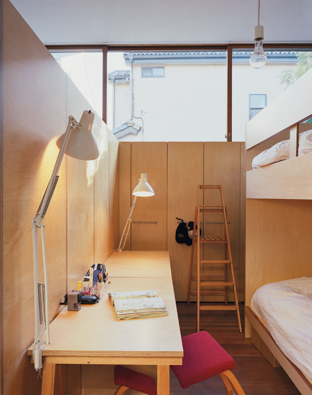 The boys' bedroom is compact while providing room for sleep as well as study.