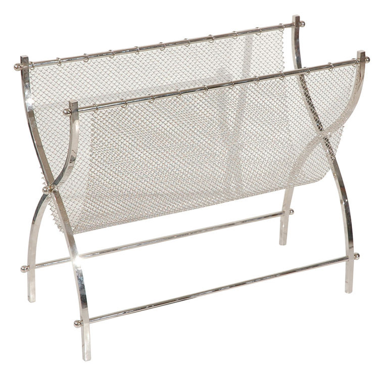 American furniture designer Charles Hollis Jones (1945–) has long been known for his acrylic and Lucite pieces of the 1970s, but his metalwork is just as significant. This 1961 piece is constructed of nickeled steel and mesh; it's signed and dated. For mo