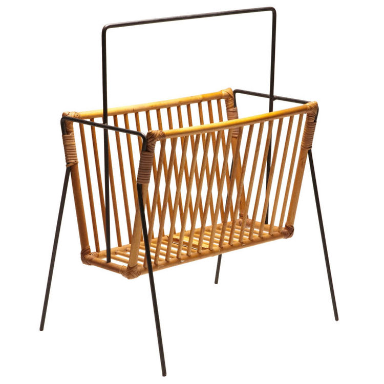 "This circa-1950 wrought-iron-and-rattan rack was designed by American Industrial designer Tony Paul, who first garnered attention in 1940s New York for his metal-wire lighting and furniture pieces. For more information, contact <a href=""http://www.dualmod"