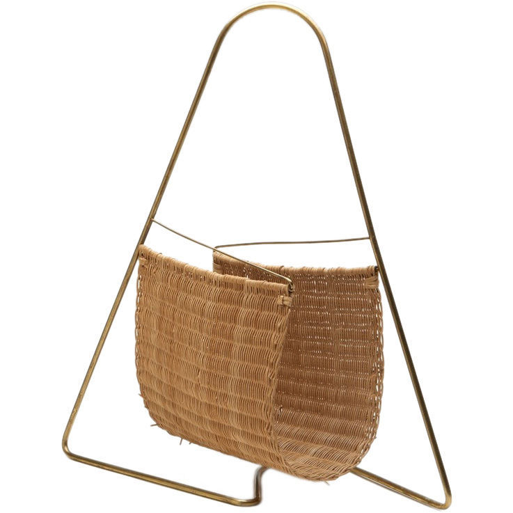 "Constructed of woven cane and brass, this circa-1950s rack is simple and beautiful. Unfortunately the designer is unknown. For more information, contact <a href=""http://samkaufman.com/search.php"">Sam Kaufman</a>."