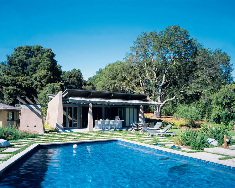Colored concrete walls, pivoting glass doors, and a scissor-shaped steel roof maintain the fun and modern feel of this computer-game designer's suburban poolside shelter.<br /><br /><strong>Project:</strong> Traeger Pool House <strong>Architect:</strong>