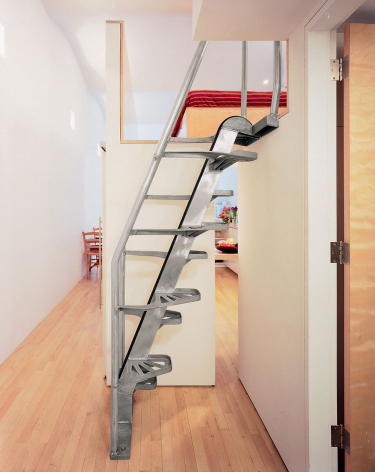 """""""The stair [by Lapeyre Stair] is very cost-effective, as compared to building woodwork,"""" Woo explains. """"It occupies very little space, and you can come down without holding the rail."""" Of the small gap that reveals the kitchen, he says, """"That's very import"""