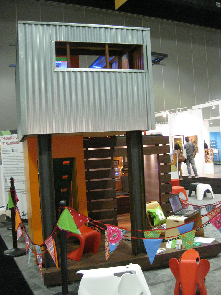 """A corrugated-metal-clad children's playhouse, designed by architect Jonathan Davis of <a href=""""http://www.piecehomes.com/"""">pieceHomes</a>, towered over the center of the Modern Family Zone."""
