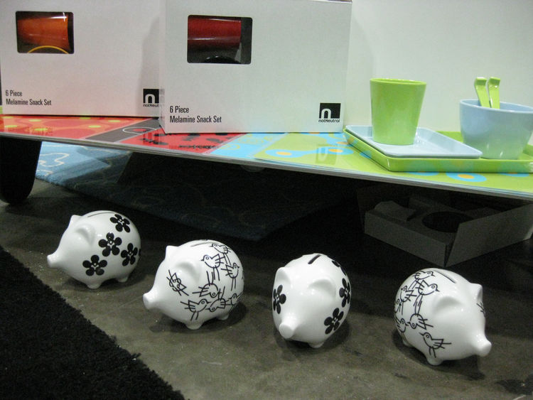 """A display of a six-piece melamine snack set and a collection of bold black-and-white piggy banks by <a href=""""http://www.notneutral.com/"""">notNeutral</a>. NotNeutral specializes in bright colors and patterns, creating """"design-orientated lifestyle products b"""