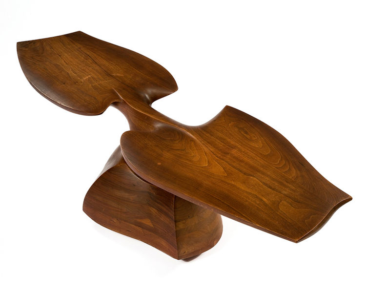 Laminated walnut coffee table by Wendell Castle