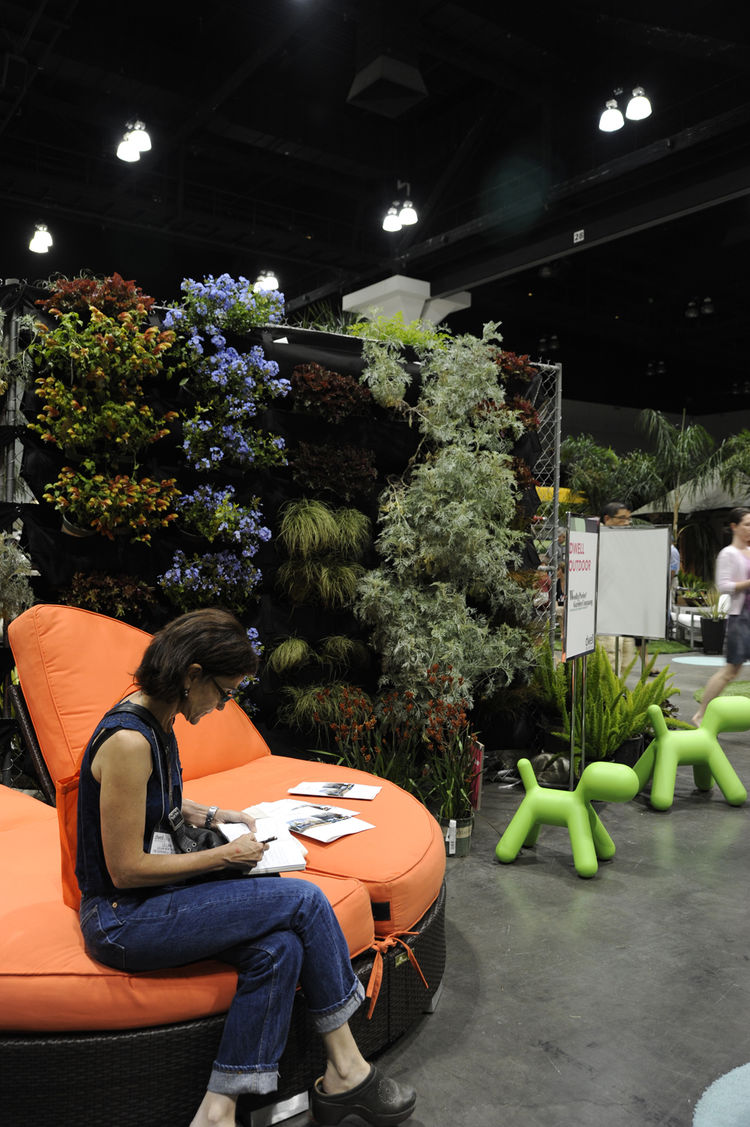 """A Dwell visitor rests near a living wall and more Eero Aarnio–designed <a href=""""http://www.magismetoo.com/Site/HomePage.php"""">Magis</a> puppies."""