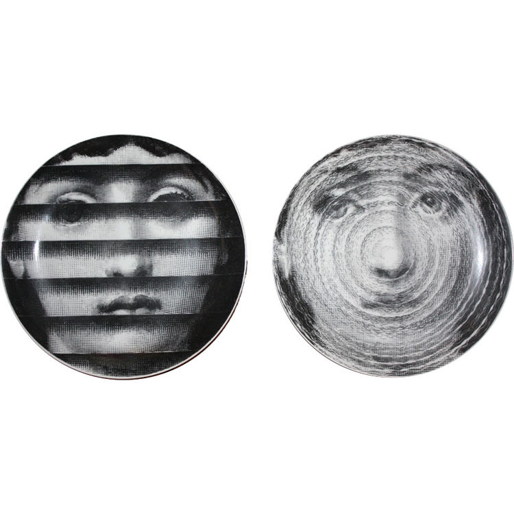 <strong>Piero Fornasetti Plates</strong><br /> Acquired from the estate of Harold and Mary Lou Patteson Price, who commissioned Frank Lloyd Wright to build the Price Tower in Oklahoma, a dozen 1950s Piero Fornasetti themes and variations added a striking