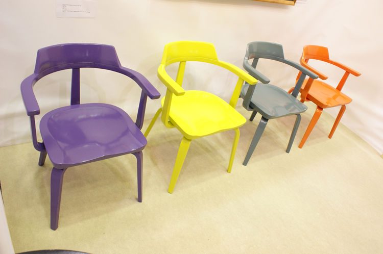 <strong>Walter Gropius Armchairs</strong><br /> Dealer Sam Kaufman has around 60 Walter Gropius armchairs on offer, and brought four festive examples lacquered in purple, yellow, gray, and orange to his pared-down modern booth at the show (other highlight