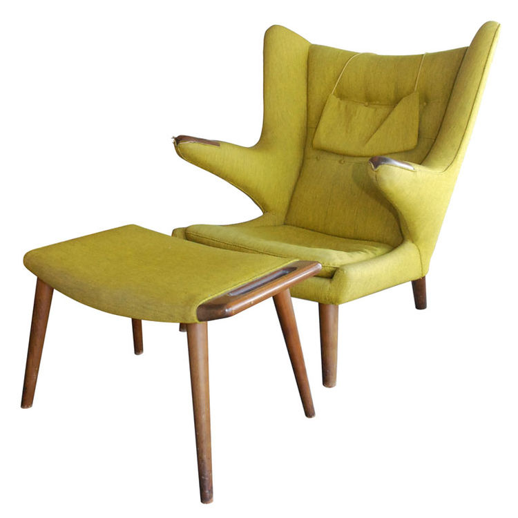 <strong>Hans Wegner Papa Bear Chair and Ottoman</strong><br /> The aptly named and oft-reproduced Papa Bear chair and ottoman by Hans Wegner is a modernist's favorite standard, yet is not usually seen with both its original ottoman and upholstery intact.