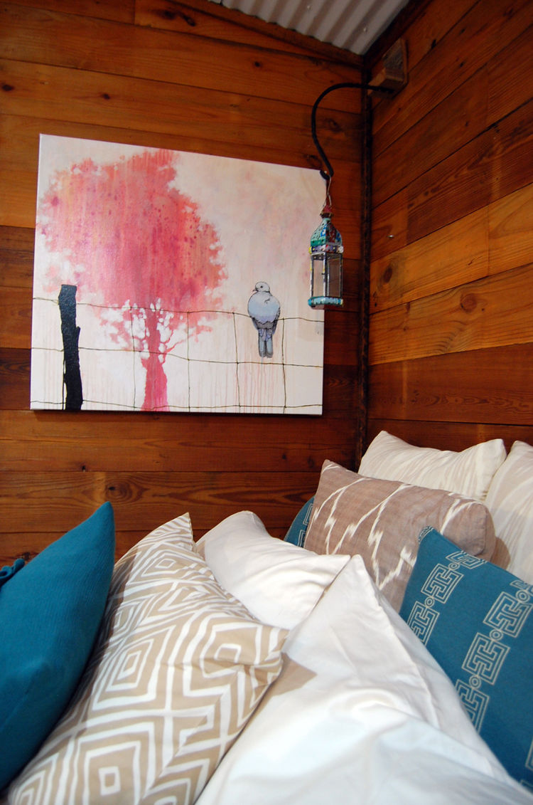 """The interior living space is designed by <a href=""""http://www.ecofabulous.com/"""">Ecofabulous</a> and furnished with high-quality vintage, re-purposed and reclaimed items found on eBay."""