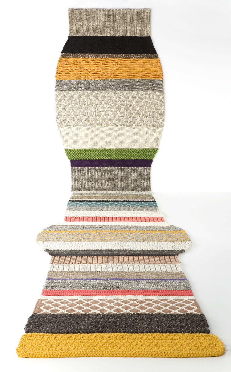 Mangas rug by Patricia Urquiola for Gandia Blasco. Huge patchwork wool weaving, loads of texture, this series is offered in eight different varieties that vary in shape and color. Beautiful.
