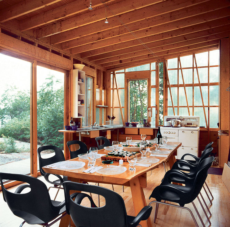 On Shoal Lake, which straddles the borders of Manitoba and Ontario, Herbert Enns hand-built a series of pavilions that would serve as an inexpensive family compound. In the dining and cooking pavilion, some creature comforts, like Karim Rashid Oh chairs,