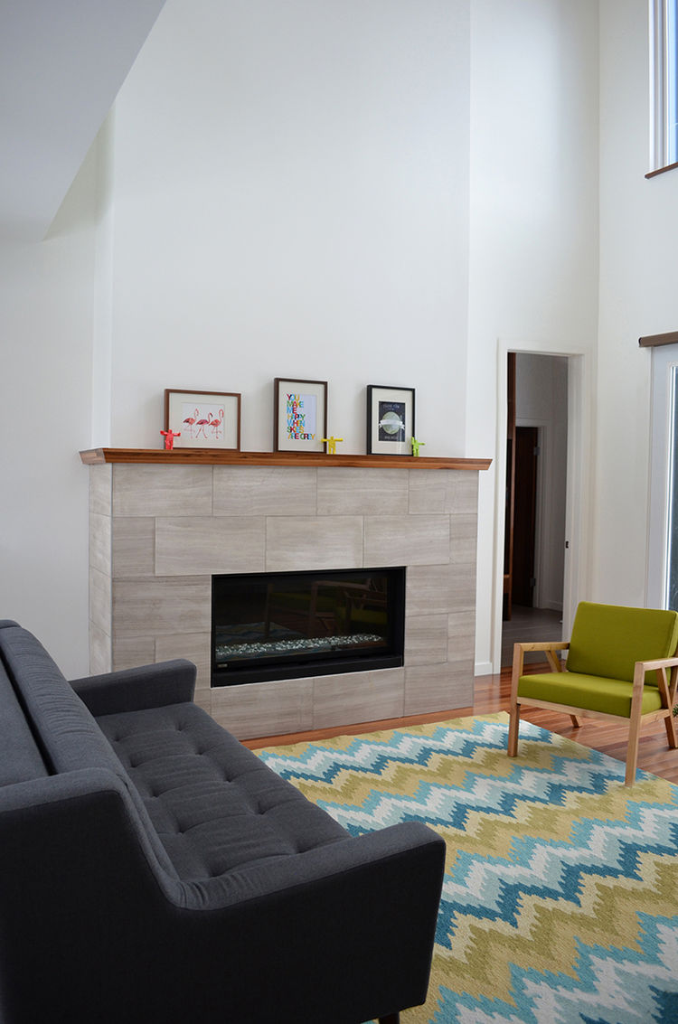 Modern living room with fireplace and colorful rug