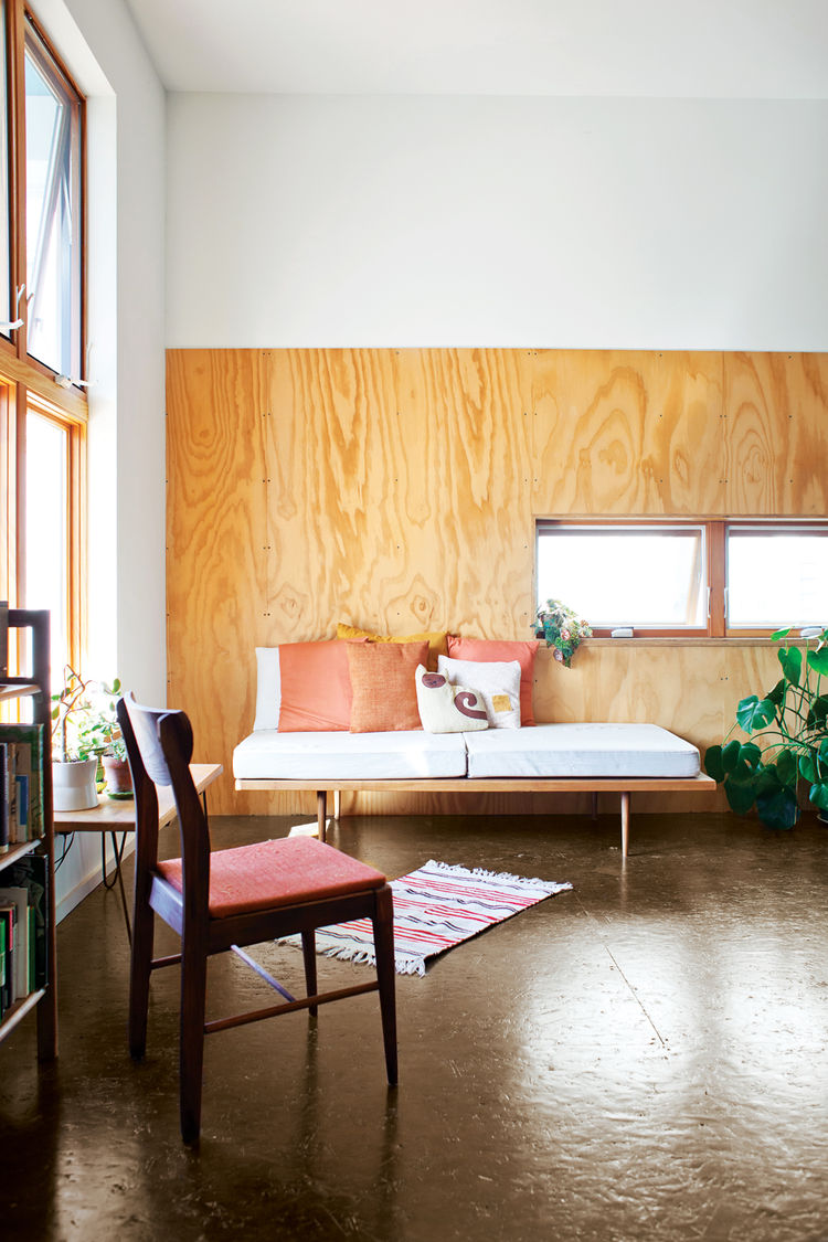 Living room with polyurethane-coated plywood walls