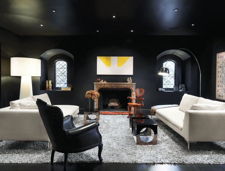 Modern living room with black walls and light furniture
