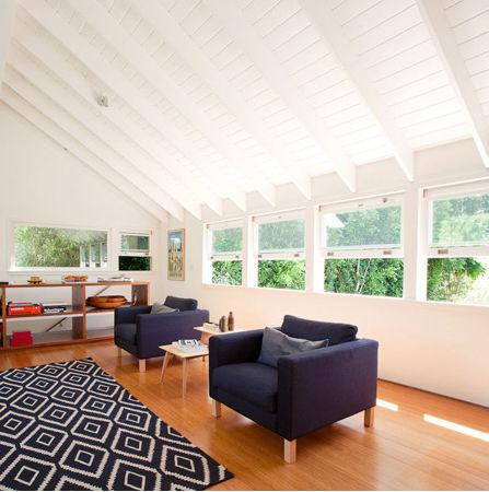 Modern second floor room with wooden flooring