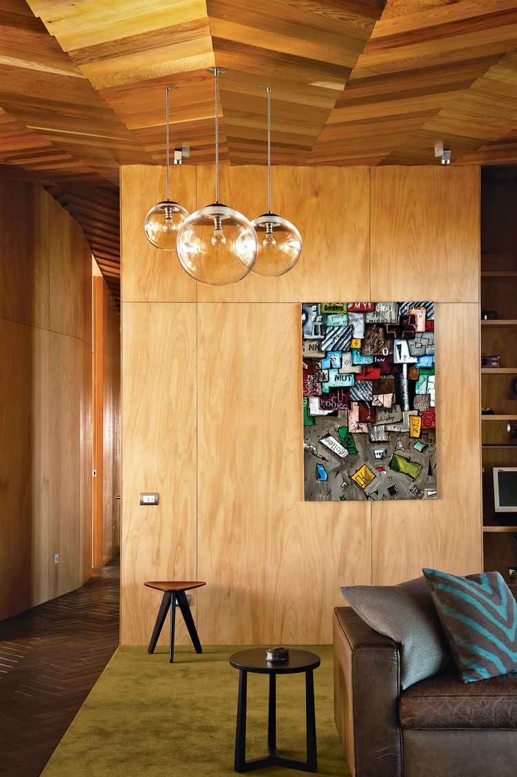 Modern wooden living area with blown glass pendant lights