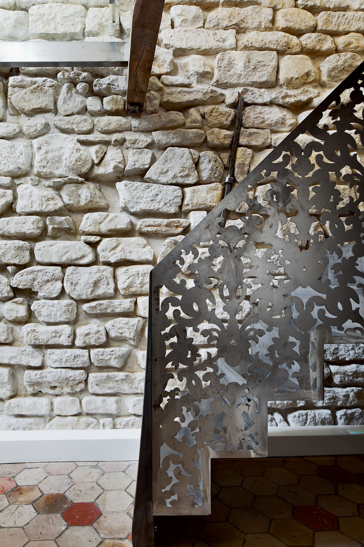 Perforated metal staircase in Paris apartment