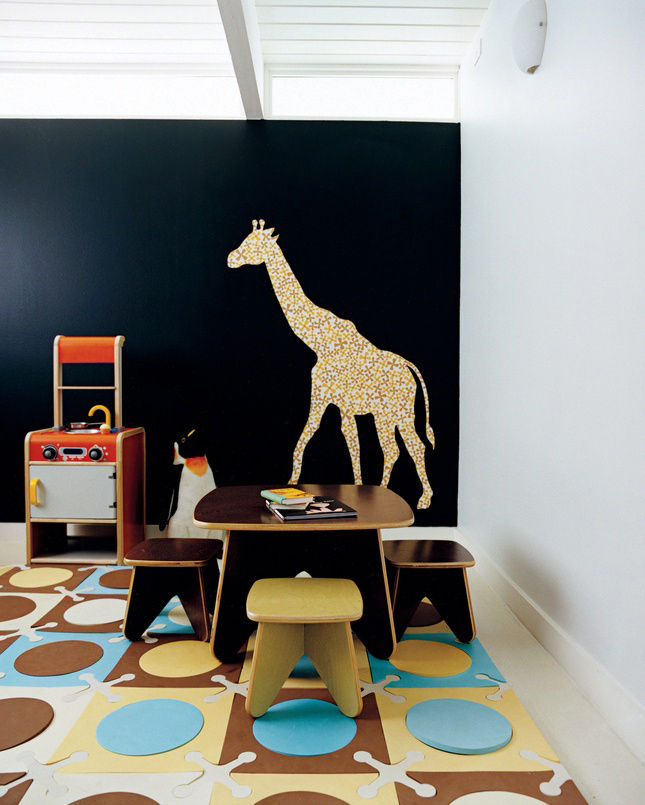 Modern playroom with wall decal and furniture