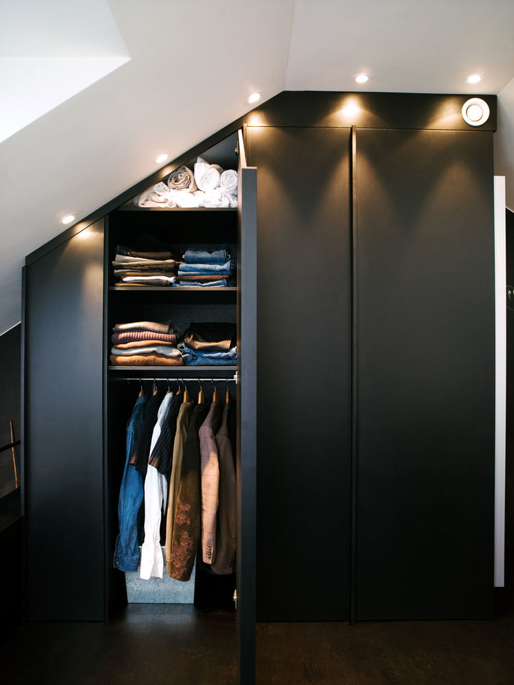 Modern built-in closets with side mirrors and lighting