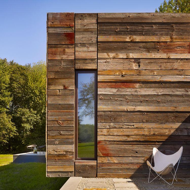 Modern rural loft made of sourced wood