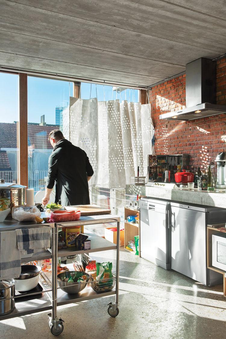 Julien De Smedt in the kitchen of his Belgium apartment.