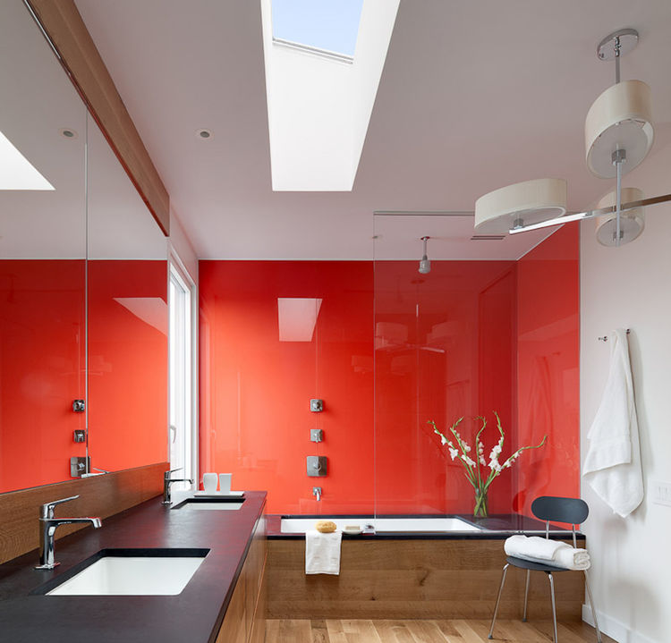 modern bathroom with orange accent wall
