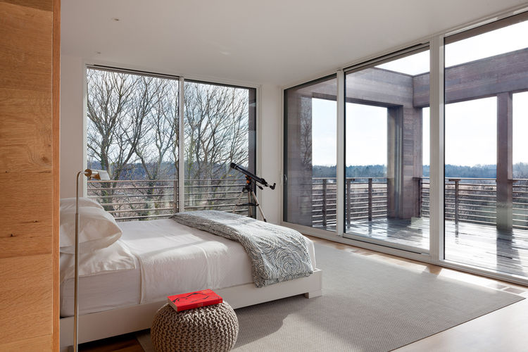 modern bedroom with floor-to-ceiling windows