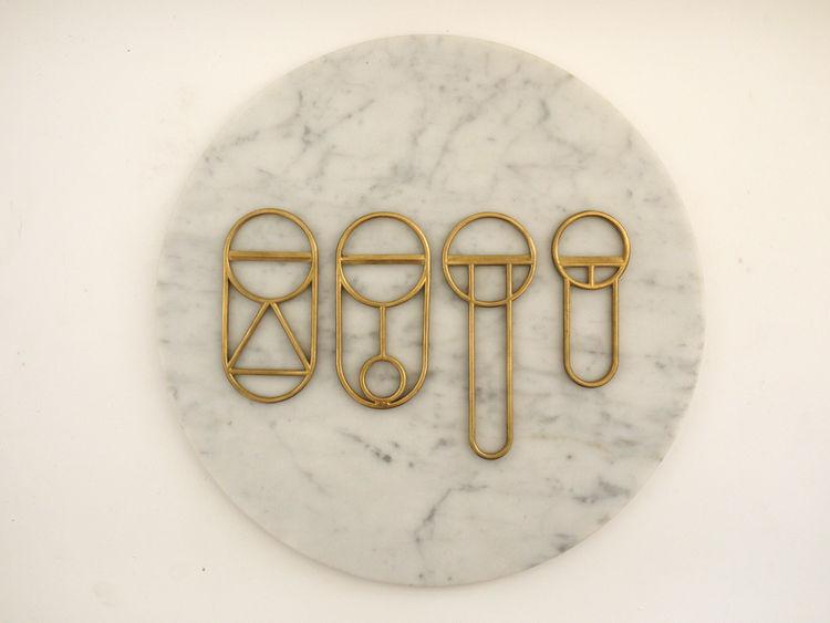 Cast-brass bottle openers by Fort Standard