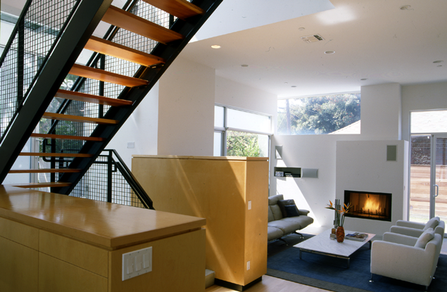 Modern living room with staircase and wooden furniture