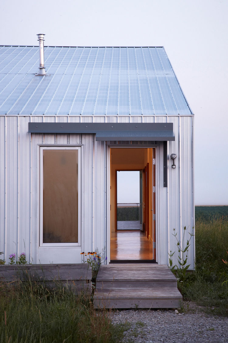 Exterior view of modern home with galvanized steel roof