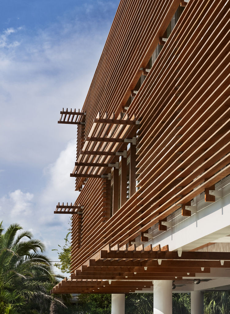 Modern interpretation of a Charleston single clad in ipe wood louvers that encourage a cross breeze.