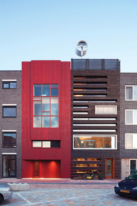 Amsterdam modern house facade charred wood