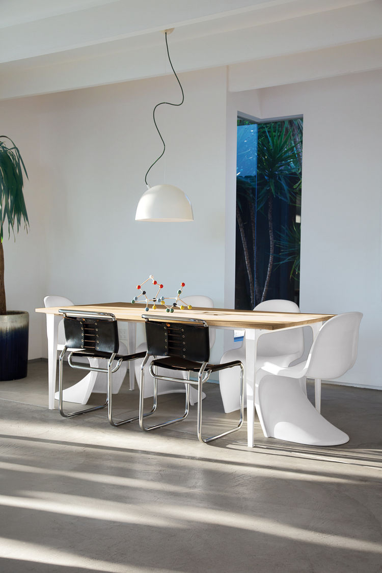 Dining room with table from CB@, chairs from Danish Modern L.A, and lamp from A+R.